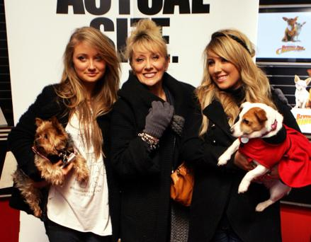 Twink with her daughters (L to R) Naomi holding Jilly the dog & Chloe holding Rosie the dog in 2009.