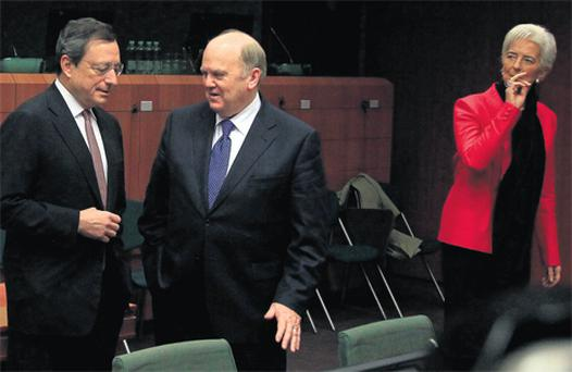 Finance Minister Michael Noonan chatting with ECB President Mario Draghi in Brussels yesterday while IMF Managing Director Christine Lagarde looks on.