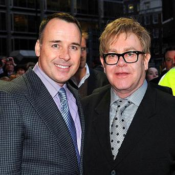 Sir Elton John and his partner David Furnish are to have a second baby, it has been reported