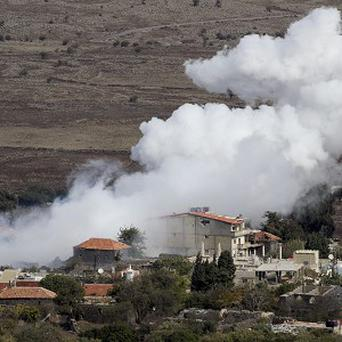 Smoke rises in the Syrian village of Bariqa, near the Israeli-Syrian border (AP)
