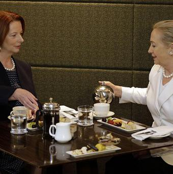 Australian Prime Minister Julia Gillard, left, meets US secretary of state Hillary Clinton in Perth (AP)