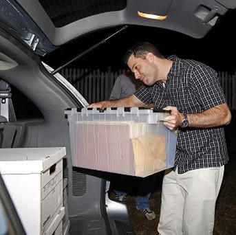 FBI agents carry boxes from the home of Paula Broadwell in North Carolina (AP)