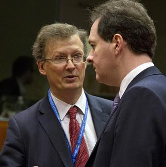 George Osborne, right, attends a meeting of EU finance ministers in Brussels (AP)