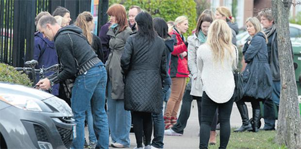 Anxious parents wait to collect their children from class at Dalkey Project School