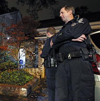Police stand guard outside the home of Paula Broadwell, the woman whose affair with David Petraeus led to his resignation as CIA director (AP)