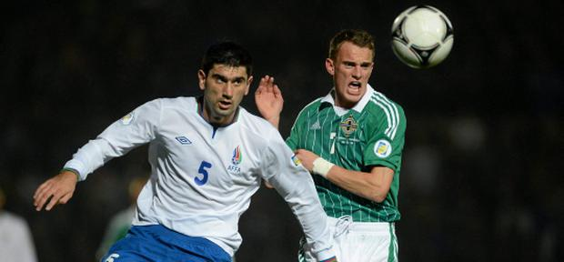 14 November 2012; Dean Shiels, Northern Ireland, in action against Rasim Ramaldanev, Azerbaijan. 2014 FIFA World Cup Qualifier Group F, Northern Ireland v Azerbaijan, Windsor Park, Belfast, Co. Antrim. Picture credit: Oliver McVeigh / SPORTSFILE