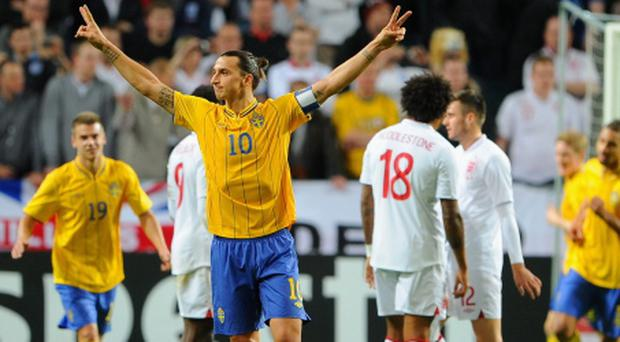 STOCKHOLM, SWEDEN - NOVEMBER 14: Zlatan Ibrahimovic of Sweden celebrates scoring his third goal during the international friendly match between Sweden and England at the Friends Arena on November 14, 2012 in Stockholm, Sweden. (Photo by Michael Regan/Getty Images)