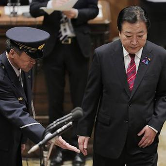 Japanese prime minister Yoshiko Noda arrives at a debate in parliament (AP)