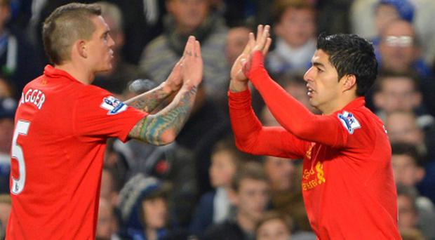 Liverpool's Luis Suarez (R) celebrates his goal against Chelsea with Daniel Agger during their English Premier League soccer match at Stamford Bridge Stadium in London November 11, 2012. REUTERS/Russell Cheyne (BRITAIN - Tags: SPORT SOCCER) NO USE WITH UNAUTHORIZED AUDIO, VIDEO, DATA, FIXTURE LISTS, CLUB/LEAGUE LOGOS OR