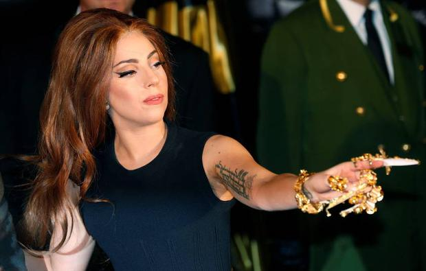 Lady Gaga arrives for the UK launch of her new fragrance 'Fame' outside Harrods in London.