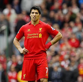 Luis Suarez signed a contract extension with Liverpool in the summer