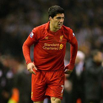 Luis Suarez has re-affirmed his commitment to Liverpool