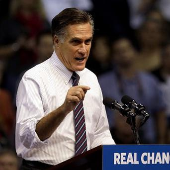 Miitt Romney says Barack Obama won the election because he offered 'gifts' to supporters (AP)