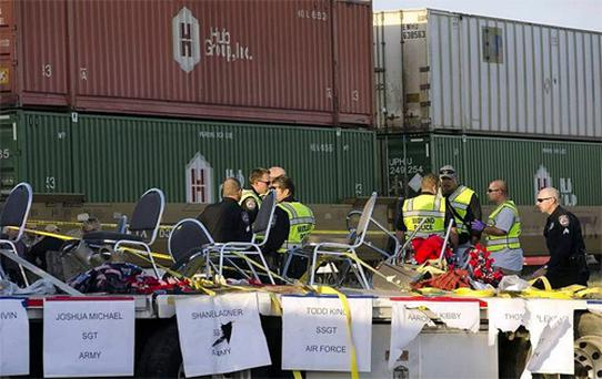 Midland police, fire and sheriffs respond to an accident where a trailer carrying veterans in a parade was struck by a train. Photo: AP
