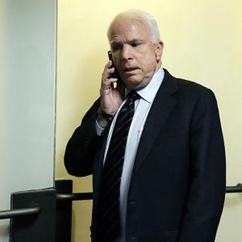 Senator John McCain returns for a closed-door heaing about the deadly attack on the US Consulate in Benghazi, Libya (AP)