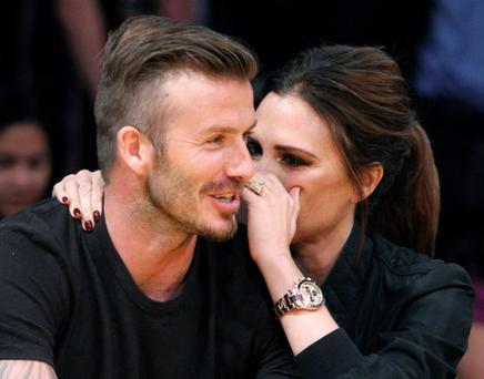 Soccer star David Beckham sits with his wife Victoria during the Los Angeles Lakers against Denver Nuggets NBA playoff game in Los Angeles...Soccer star David Beckham sits courtside with his wife Victoria during Game 2 of the Los Angeles Lakers against Denver Nuggets NBA Western Conference quarter-final basketball playoff game in Los Angeles, California May 1, 2012. REUTERS/Alex Gallardo (UNITED STATES - Tags: SPORT BASKETBALL ENTERTAINMENT SOCCER)...S