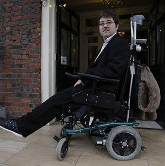 Padraic Moran has challenged health minister James Reilly to spend a day in a wheelchair before any more cuts are made to home care services