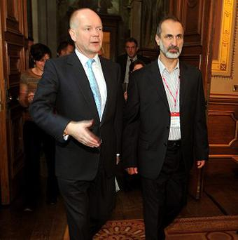 Foreign Secretary William Hague and Sheikh Ahmed Mu'az Al-Khatb, president of the Syrian opposition movement