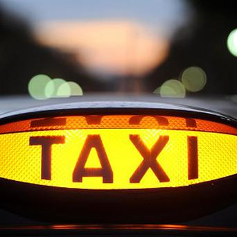 A taxi driver faces disciplinary action after being caught watching a football match on his phone while driving with passengers in his vehicle