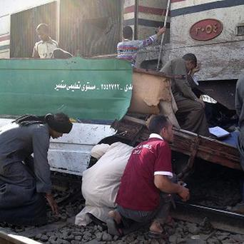 Distraught Egyptians searched for signs of their loved ones in the wreckage of a train crash that killed at least 49 people (AP)