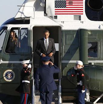 President Barack Obama steps from the Marine One helicopter before boarding en route to Burma (AP)
