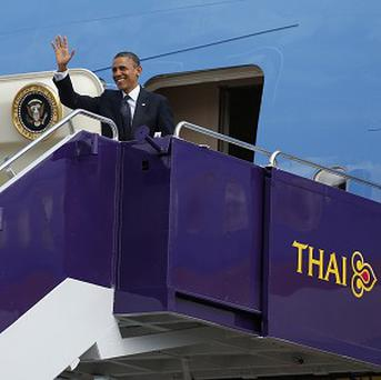 President Barack Obama waves as he steps off Air Force One at Don Mueang International Airport in Bangkok, Thailand (AP)