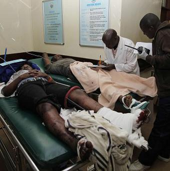 A person injured in a blast on a bus is attended to by medical staff at a hospital in Nairobi (AP)