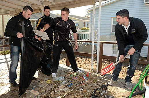 Cork's Donal Og Cusack and Dublin's Michael Darragh MacAuley, Paul Flynn and Bernard Brogan help the clean-up in Breezy Point