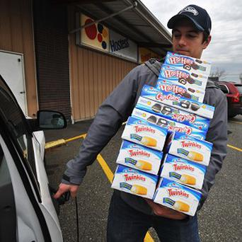 Andy Wagar loads Twinkies, Ho-Hos and Cup Cakes into a van outside the Wonder Bakery Thrift Shop in Bellingham, Washington (AP)