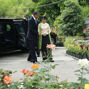 US president Barack Obama is greeted by democracy activist Aung San Suu Kyi (AP)