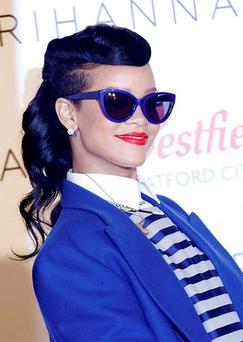 She wore sunglasses rimmed in a matching hue to her blazer to finish off her statement look.