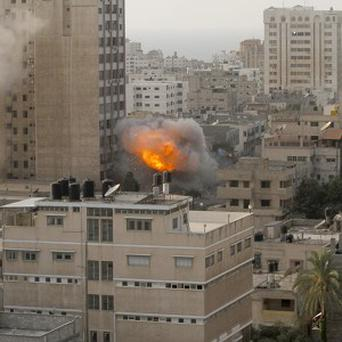 Smoke and fire from an explosion by a high rise housing media organizations in Gaza City (AP/Hatem Moussa)