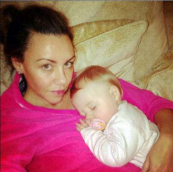 Michelle posted: 'My last cuddle with #babyfaith before my op.. dont know when she will be able to cuddle upto me again.. '