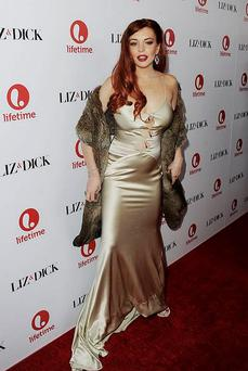 Lindsay Lohan arrives at a party to celebrate Lifetime's 'Liz & Dick' at the Beverly Hills Hotel on November 20, 2012 in Beverly Hills.