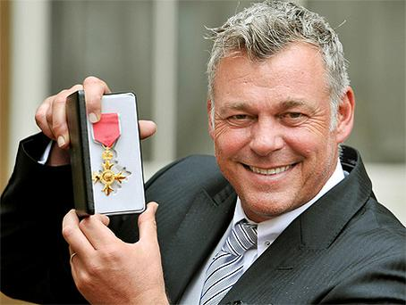 Darren Clarke with his OBE for services to golf