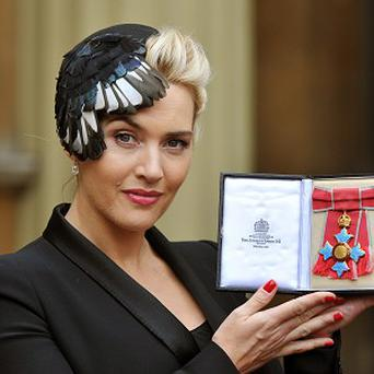 Kate Winslet chatted about motherhood when she received her CBE from the Queen