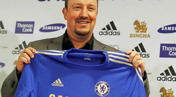 Chelsea's new interim manager Rafael Benitez holds a jersey during a press conference. Getty