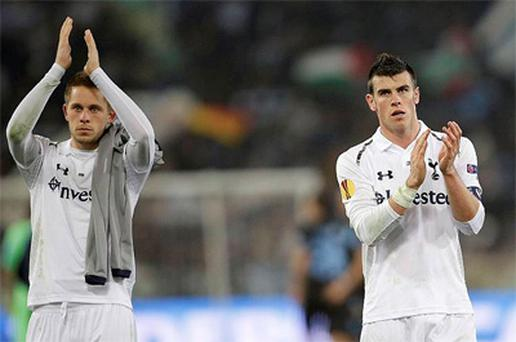 Tottenham's Gareth Bale and Gylfi Sigurdsson greet supporters at the end of their Europa League soccer match against SS Lazio