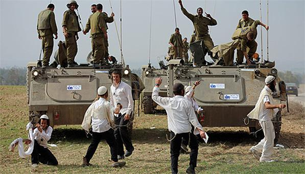 Hassidic Jewish boys show support for Israeli soldiers at the border with Gaza