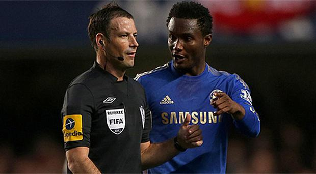 John Obi Mikel talks to referee Mark Clattenburg during the Premier League match between Chelsea and Manchester United at Stamford Bridge last month