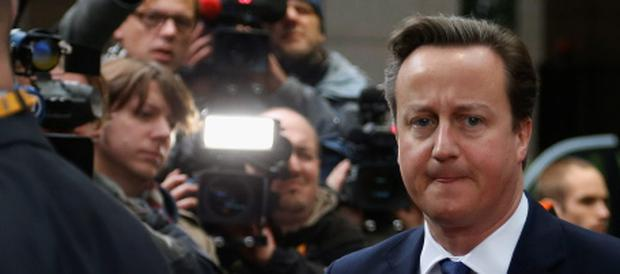 Britain's Prime Minister David Cameron arrives at the European Union (EU) council headquarters for an EU leaders summit discussing the EU's long-term budget in Brussels November 23, 2012. Prospects of a deal on the EU's long-term budget dimmed on Friday after a fresh compromise proposal offered concessions to France and Poland but ignored British and German demands for deeper overall spending cuts. REUTERS/Francois Lenoir (BELGIUM - Tags: BUSINESS POLITICS)