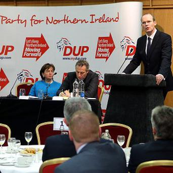 Agriculture Minister Simon Coveney, right, addresses the DUP's annual conference