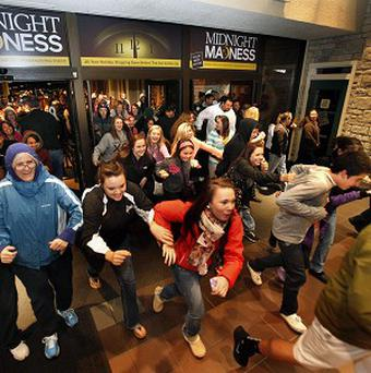 Shoppers pour into the Valley River Centre for the Midnight Madness sale in Eugene, Oregon (AP/The Register-Guard, Brian Davies)