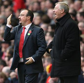 Sir Alex Ferguson, right, and Rafael Benitez have a feud from the Spaniard's Liverpool tenure