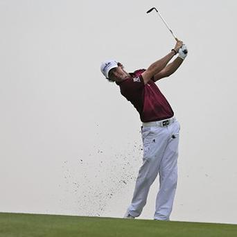Rory McIlroy, pictured, will be going head-to-head with Luke Donald (AP)