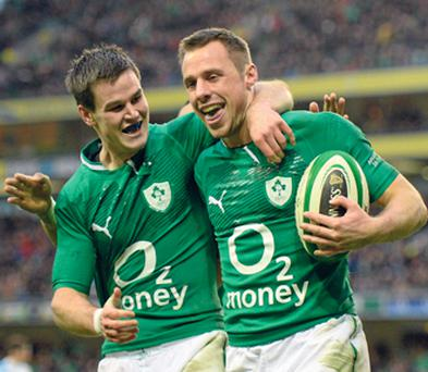 Tommy Bowe celebrates with team-mate Jonathan Sexton after scoring his second try in Ireland's 46-24 win over Argentina at the Aviva Stadium yesterday.