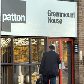 People arrive at Patton construction headquarters in Ballymena, Co Antrim, as administrators announce more job losses