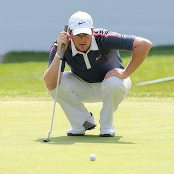 Marc Warren, pictured, is tied for the halfway lead with Rory McIlroy and Luke Donald