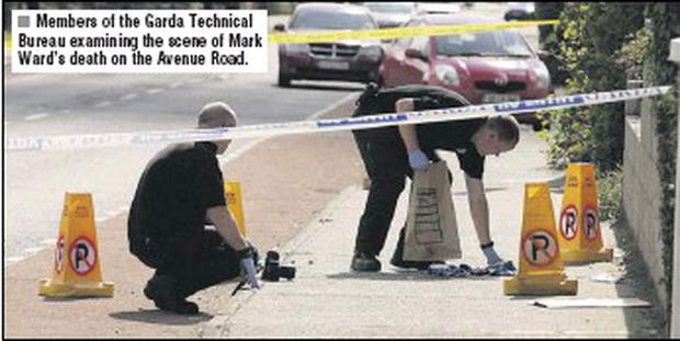 Members of the Garda Technical Bureau examining the scene of Mark Ward's death on the Avenue Road.