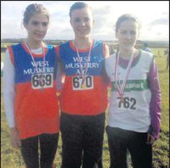 First three in the Junior Girls Race at County Senior in Carrignavar. Rachael O`Shea 1st (middle) Annemarie O`Connor 2nd (Left) and Laura Gowen 3rd (Right). Credit: Picture: Courtesy of St Val's.